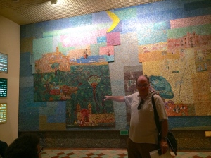 Elan teaching us about the mosaic depicting Tel Aviv's history